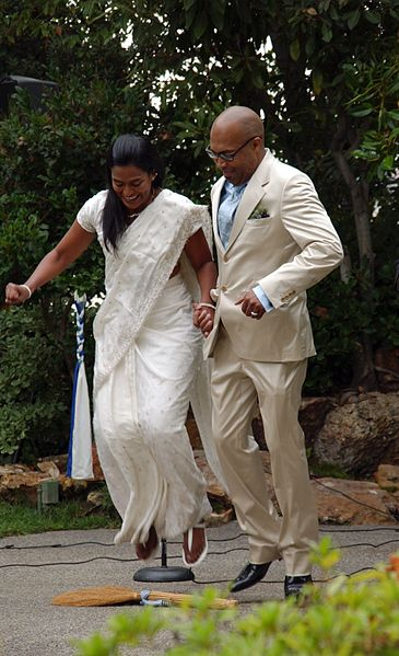 Couple jumping the broom2