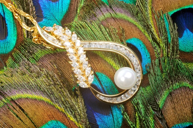 diamond necklace on peacock feathers